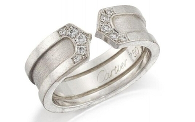 A diamond ring, by Cartier, the wide...