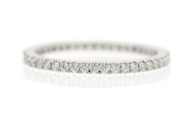 NOT SOLD. A full diamond eternity ring set with numerous diamonds weighing a total of...