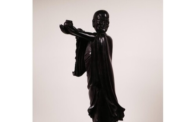 A large Chinese carved hardwood figure of Lohan holding a ce...