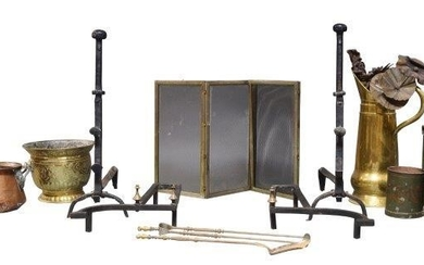 A large pair of wrought iron andirons,...
