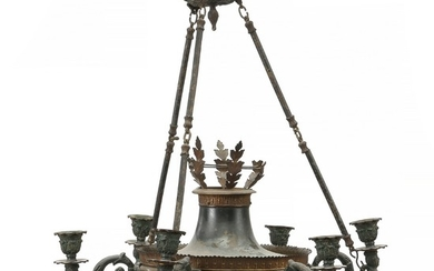 A late 19th century Empire style brass and patinated metal chandelier, six branches. H. 65 cm. Diam. 55 cm.
