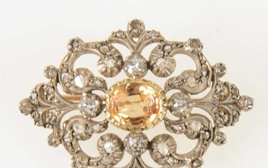 A late Victorian diamond brooch with golden yellow stone to centre