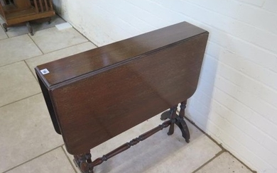 A late Victorian mahogany Sutherland table on turned support...
