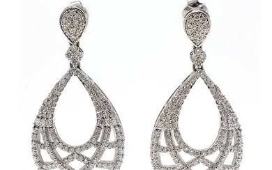 A pair of diamond ear pendants each set with numerous brilliant-cut diamonds totalling app. 3.87 ct., mounted in 14k white gold. L. 4 cm. (2)