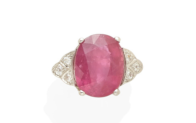 A platinum, pink sapphire, and diamond ring
