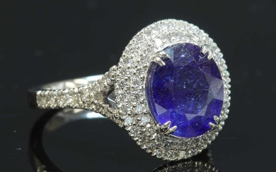 A platinum sapphire and diamond oval cluster ring