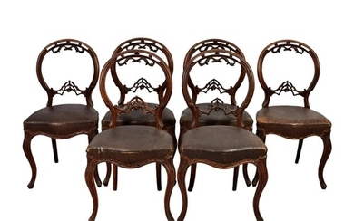 A set of six Victorian walnut balloon back dining chairs, th...