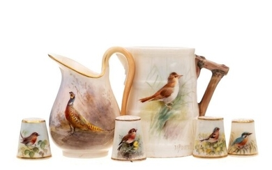 A small group of Royal Worcester miniature bird painted piec...