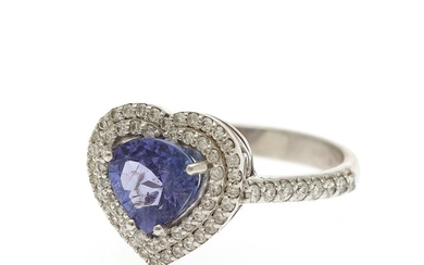 A tanzanite and diamond ring set with a heart-shaped tanzanite and numerous brilliant-cut diamonds, mounted in 14k. Size 54.5.