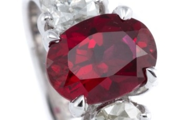 AN 18CT WHITE GOLD DIAMOND AND STONE SET RING; centring an oval cut synthetic ruby adjacent to 2 pear brilliant cut diamonds totalli...