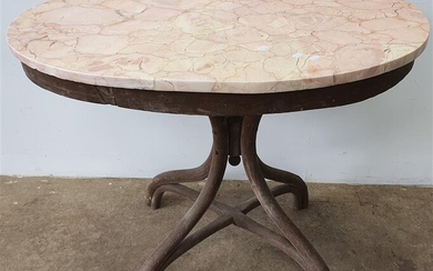 AN OVAL BENTWOOD MARBLE TOP TABLE