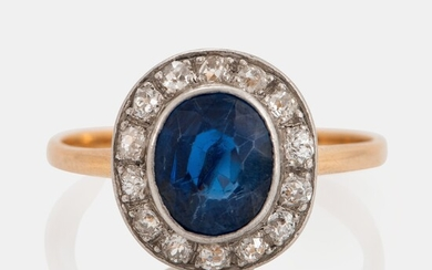 An 18K gold ring set with a faceted sapphire weight ca 2.00 cts and old-cut diamonds