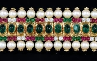 An Emerald, Ruby, Diamond and Pearl Bracelet, 20th Century,...