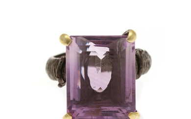 An amethyst ring set with an emerald-cut amethyst, mounted in black rhodium plated and partly gilded sterling silver. Size 56.