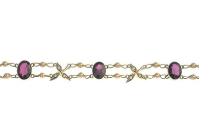 An early 20th century 15ct gold oval-shape garnet and