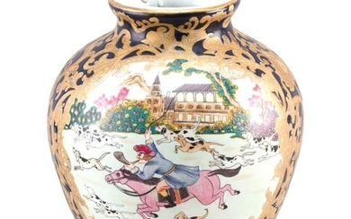 CHINESE PORCELAIN VASE With two famille rose cartouches with western decoration of a fox hunt on a cobalt blue ground with heavy gil...
