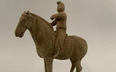 Chinese Pottery Figure Of a Man on a Horse 15-1/2'' H