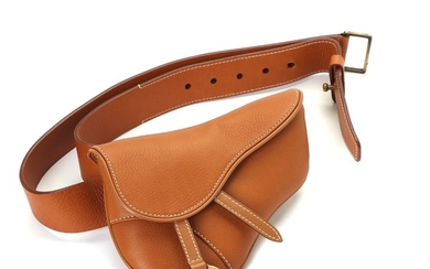 """Christian Dior: A """"Saddle clutch belt"""" bag made of light brown leather with golden hardware, a magnetic closure and one compartment."""