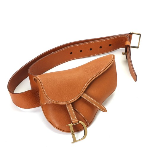 "Christian Dior: A ""Saddle clutch belt"" bag made of light brown leather with golden hardware, a magnetic closure and one compartment."
