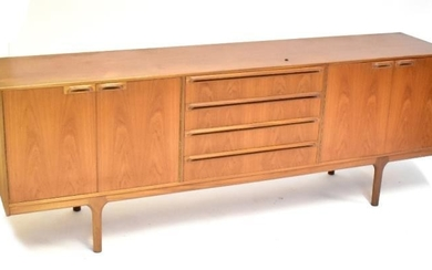 MCINTOSH & CO; a teak sideboard with four central...