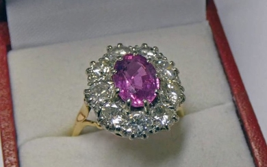 PINK SAPPHIRE & DIAMOND CLUSTER RING, THE OVAL PINK...