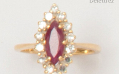 Yellow gold ring set with a shuttle ruby in a ring of brilliant-cut diamonds. Finger size: 47. Rough: 3.3g.