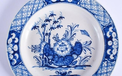 18th c. Bow plate painted in blue with a large flowers