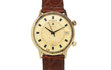 Jaeger-LeCoultre. A gold plated automatic calendar alarm wristwatch