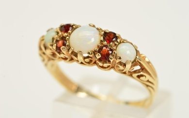 A 9CT GOLD OPAL AND GARNET RING, designed as three graduated...