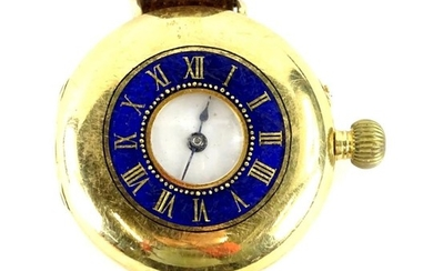 A 9ct gold half hunter fob watch, converted to a wristwatch.