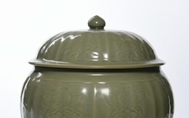 A CHINESE CELADON RIBBED JAR AND COVER, CHINA