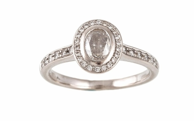 A DIAMOND SOLITAIRE RING, with oval cut centre diamond to a ...