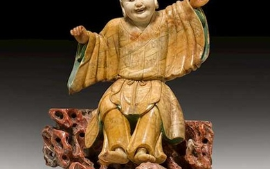 A FINELY CARVED SOAPSTONE FIGURE OF LIU HAI AND HIS TOAD.