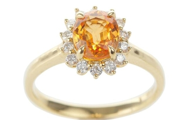 A GARNET AND DIAMOND CLUSTER RING IN 18CT GOLD, CENTRALLY SET WITH AN OVAL CUT SPESSARTINE GARNET OF 2.13CTS, SURROUNDED BY ROUND BR...