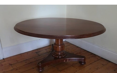 A George IV mahogany supper table, the oval top above bell s...