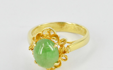 A JADE AND GOLD RING