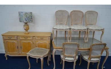 A MODERN BLEACHED WOOD FRENCH DINING SUITE, with wicker work...