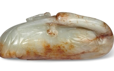 A PALE GREENISH-WHITE AND RUSSET JADE CARVING OF A RECUMBENT CRANE, CHINA, LATE MING DYNASTY, 17TH-18TH CENTURY