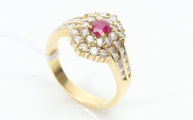 A RUBY AND DIAMOND CLUSTER RING IN 18CT GOLD, THE OVAL CUT RUBY WEIGHING 0.60CT AND DIAMONDS TOTALLING 0.40CTS, SIZE P, 7.2GMS