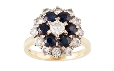 A SAPPHIRE AND DIAMOND CLUSTER RING, with sapphire of approx...