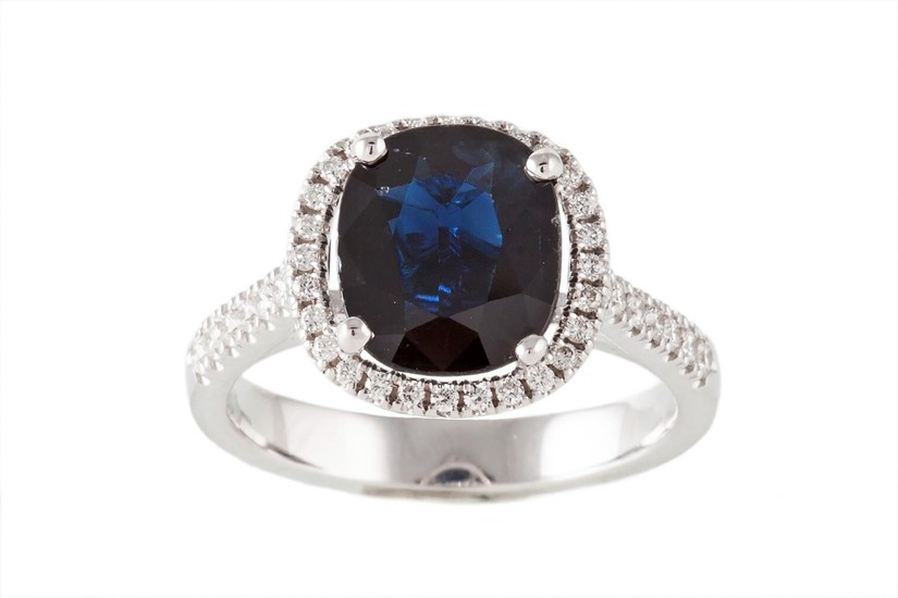A SAPPHIRE AND DIAMOND RING, the sapphire estimated to weigh...
