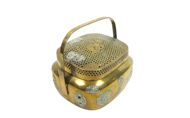 A bronze hand warmer with reticulated cover