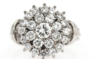 A diamond ring set with numerous brilliant-cut diamonds, mounted in 18k white gold. Size app....