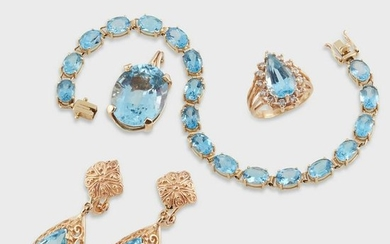 A group of blue topaz and fourteen karat gold jewelry