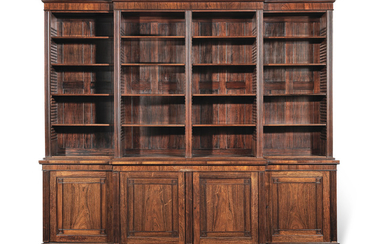 A large mid-19th century rosewood and simulated rosewood breakfront open bookcase