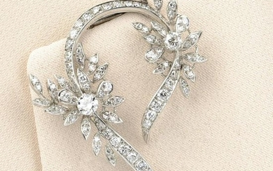 A mid 20th century 18ct gold diamond floral brooch.