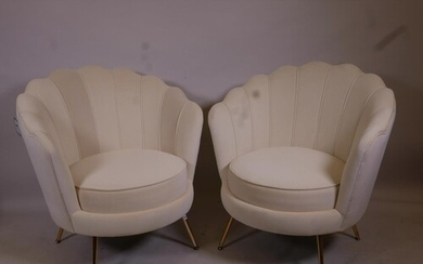 A pair of Art Deco style cream velvet clam shell chairs on b...