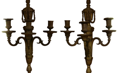 A pair of French Louis XVI patinated bronze sconces