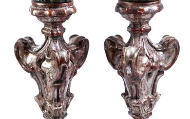 A pair of Italian carved wood torch stands...