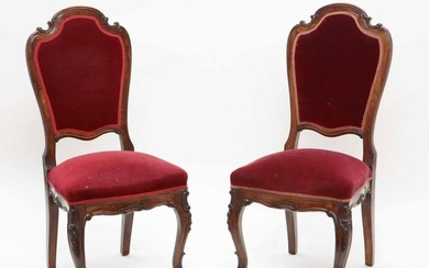 A pair of Rococo style walnut side chairs